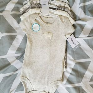 Set of 4 bodysuits.  Brand new.